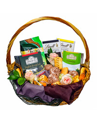 This refined gift basket includes some finest tea, chocolates and sweets.