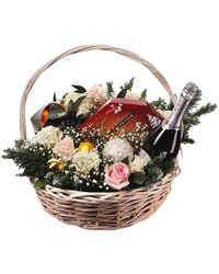 The elegant gift basket with flowers, chocolates and sparkling wine is a perfect holiday greeting!