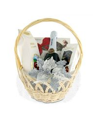 A gift basket with chocolates and Asti Martini sparkling wine.