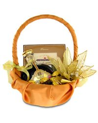 A gift basket with chocolates and a bottle of cognac in a stylish decoration.