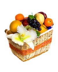 Delicious fruit & flower arrangement in a basket.