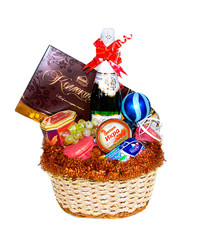 A delicious gift basket with holiday decoration.
